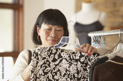 Senior Asian woman shopping for clothing