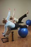 Two woman exercising on equipment