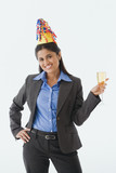 Indian businesswoman wearing party hat