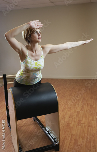 Woman exercising on equipment