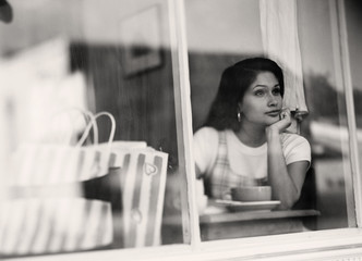 Woman looking out cafe window