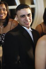 Hispanic man wearing suit at prom