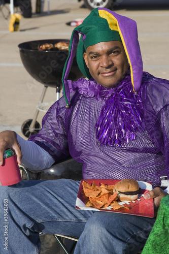 African male sports fan wearing team colors