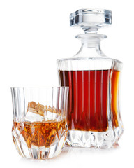 glass and decanter of brandy on a white