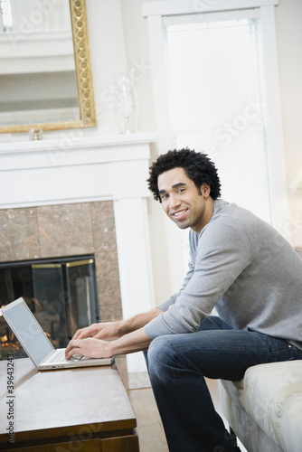 African man typing on laptop