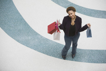 Mixed Race woman with shopping bags