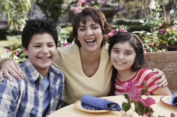 Hispanic mother and children at table