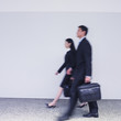 Blurred motion shot of businesspeople walking