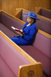 Senior African American woman in church