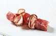 Fresh pork chunks and bacon on stick