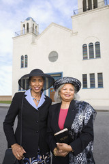 Senior African American women in front of church