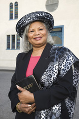Senior African American woman in front of church