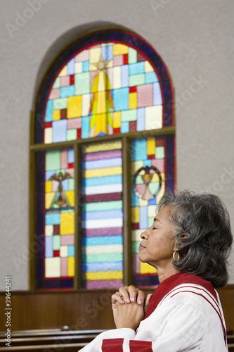 African American female Reverend praying