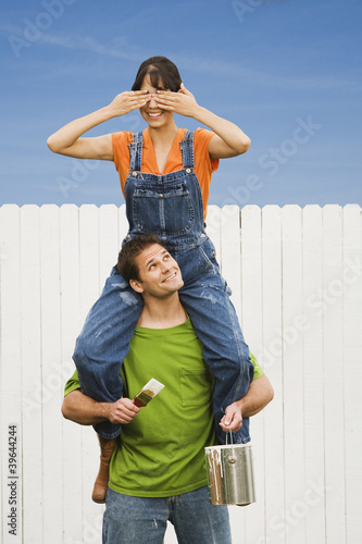 Woman sitting on boyfriend's shoulders