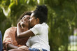 South American couple kissing in park