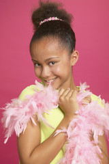African girl wearing feather boa
