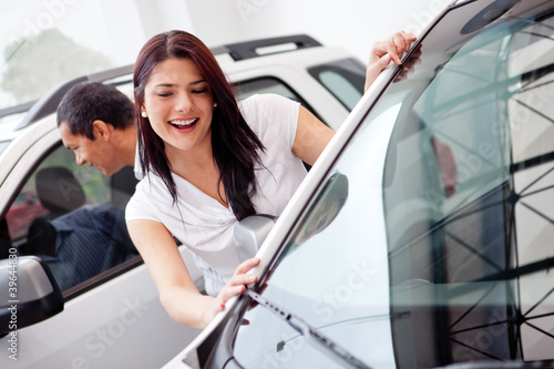 Couple looking at cars