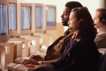 Multi-ethnic businesspeople working in call center