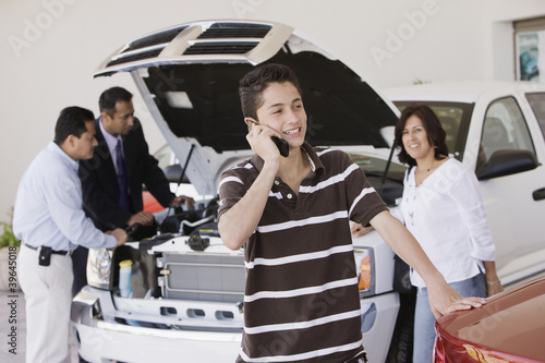 Hispanic family at car dealership