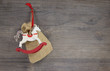 Weihnachtliche Karte mit Schaukelpferd