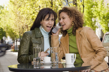Hispanic women talking on cell phone