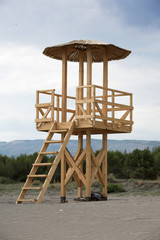 Wooden life guard tower at the sandy beach