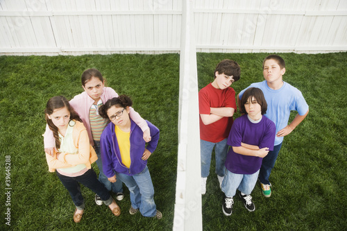 Mixed Race children on opposite sides of fence