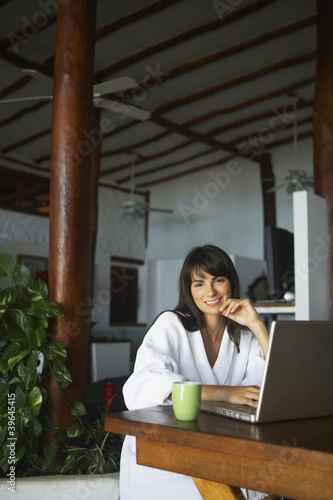 South American woman typing on laptop