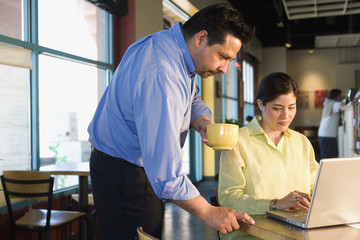 Multi-ethnic businesspeople working at cafe