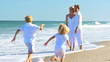Happy Caucasian Family Enjoying Beach Vacation