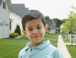 Hispanic boy in residential area