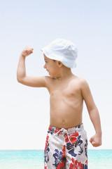 Hispanic boy flexing biceps