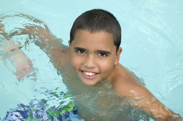 Hispanic boy in swimming pool