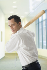 Hispanic businessman in batting stance
