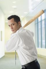 Hispanic businessman in batting stance