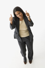 Hispanic businesswoman giving thumbs up