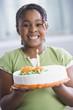 African American girl holding birthday cake