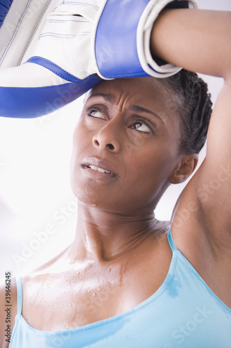 African American woman wearing boxing gloves