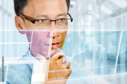 Businessman studying real time currency chart
