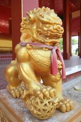 Golden lion statue on vintage