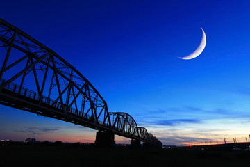 old railroad bridge silhouette at night