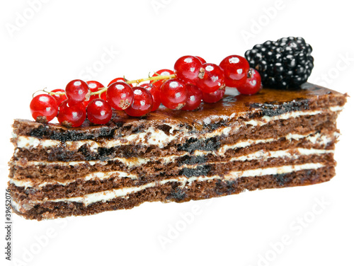 Chocolate Cake with a red currant and a blackberry