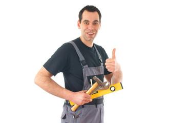 Handwerker mit Werkzeug und Daumen hoch