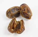 Dates sliced and whole on white background