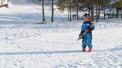 little boy with skis