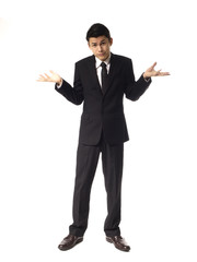 Young Asian Man shrugging Over White Background.