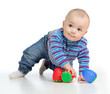 Funny little child playing with color toys, isolated over white