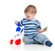 little child assembling construction set over white background