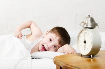Boy awaken old alarm clock