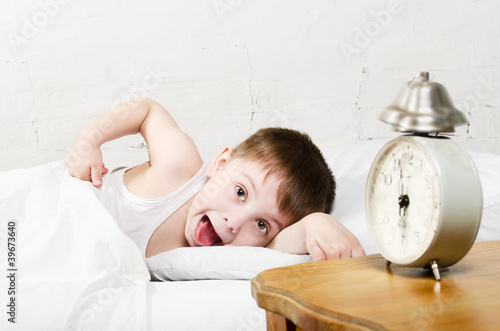 Boy awaken old alarm clock